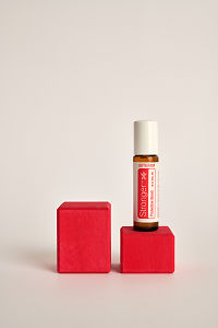doTERRA Kids Oil Collection roll-on bottle Stronger on a red wooden block.